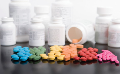 rainbow of prescription drugs with bottles