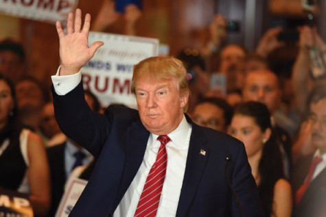 New York City - NY - USA - September 3 2015: Republican presidential candidate Donald Trump wave to press after a press conference at Trump Tower to announce he has signed a pledge not to run as an independent candidate