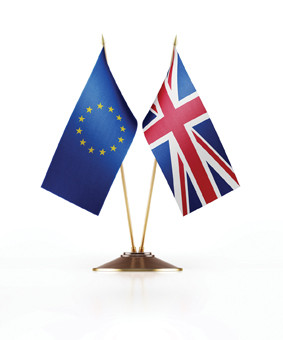 Miniature Flag of European Union and United Kingdom of England. The flag has nice fabric texture. Isolated on white background. Clipping path is included.