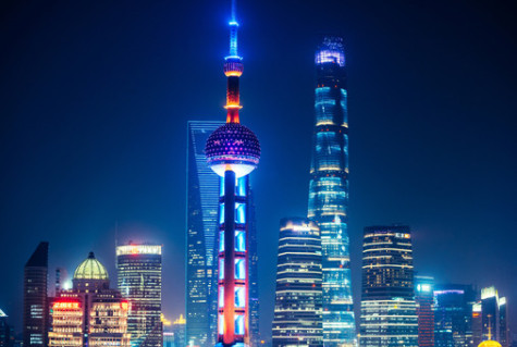 Pudong financial district, with Oriental Pearl Tower and illuminated skyscraper