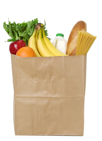 Brown grocery bag with a variety of groceries.  Please see my portfolio for other food related images.